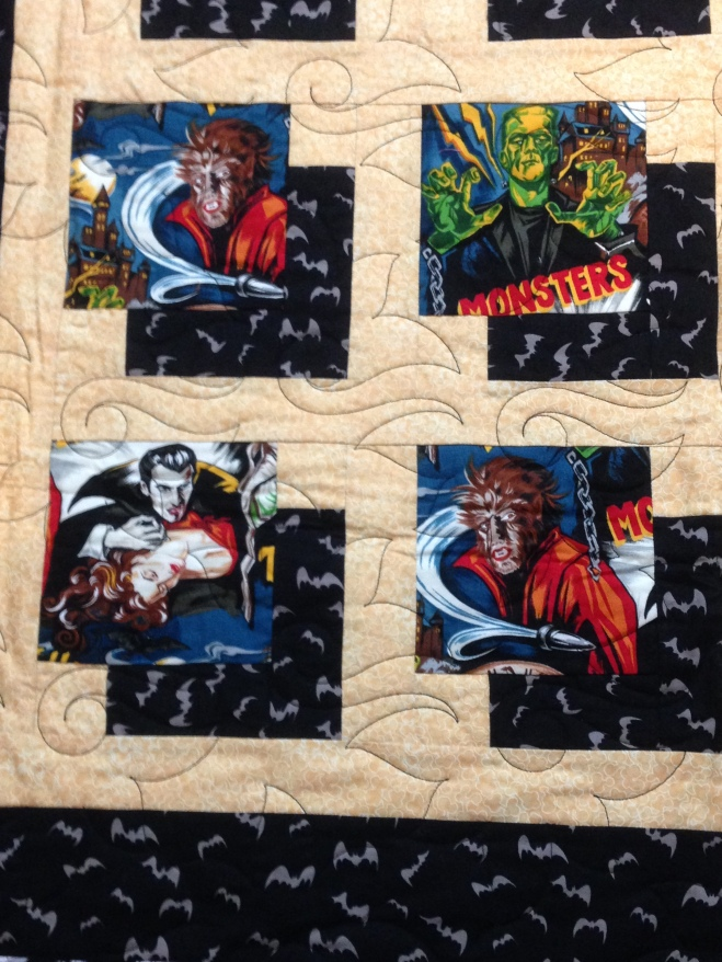 Monster Mash fabric quilt Dracula vampire Frankenstein monster mummy Wolfman bat bats film strips popcorn classic monster movies faux attic window block