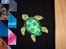 Scrap quilt Michael Miller black machine applique fusible applique zodiac Libra Aquarius Sagittarius Turtle drama pineapple