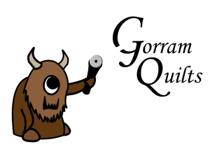 Gorram Quilts logo monster Gregorio Gorram III whimsical where the wild things are rotary cutter shop logo mascot plushie