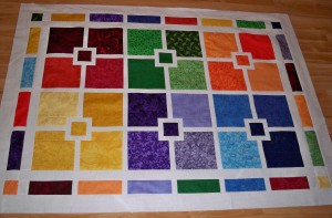 Companion cube square rectangle quilt quilts white sashing jewel toned bright colors red green orange blue purple yellow shaded
