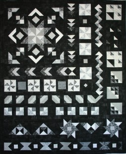 Star in the West quilt Bella Girls Monsoon Sunset Sunsets BOM Block of the Month Southwestern Pinwheel Geometric Flying Geese Black White Grey Row of the Month ROM machine quilting Handiquilter