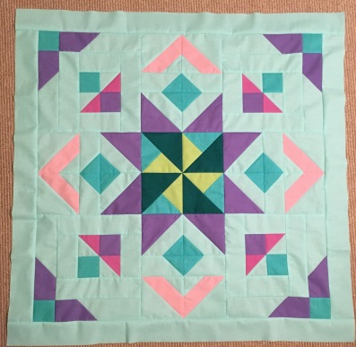 Star in the West Monsoon sunset quilt along QAL block of the month BOM 2016 geometric pinwheels stars Swan Amity American Made Brand solids AMB
