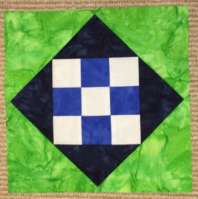Desert Bloom Quilting Talavera Tile quilt pattern half square triangles HST 4-patch four patch Prisma Dyes Artisan Batik Batiks quilt fabric solids Seattle Seahawks