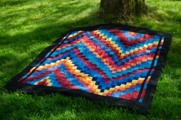 Bargello quilt rainbow fire blue red orange yellow Michael Miller black Kona