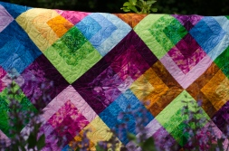 Quilter's Market Strip quilt Garden Jewels Blue Green Orange Pink Purple jewel tone finished quilt