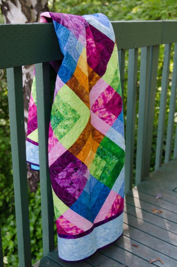 Quilter's Market Strip quilt Garden Jewels Blue Green Orange Pink Purple jewel tone finished quilt