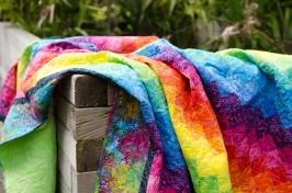 Rainbow bargello red orange yellow green blue indigo purple pink batik quilt