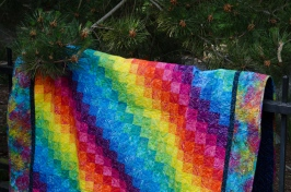 Rainbow bargello red orange yellow green blue indigo purple pink batik quilt